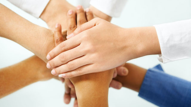 Diverse People Hand In Unity